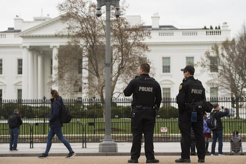 Security: Members of the Secret Service Uniformed Divison patrol the perimeter of the White House in Washington: AFP/Getty Images