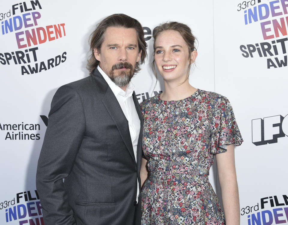 Ethan Hawke, left, and Maya Hawke arrive at the 33rd Film Independent Spirit Awards on Saturday, March 3, 2018, in Santa Monica, Calif. (Photo by Richard Shotwell/Invision/AP)