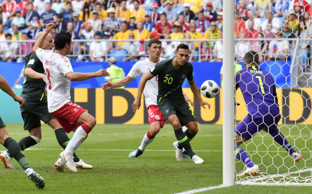Australia goalkeeper Mathew Ryan, right, makes a save during the group C match between Denmark and Australia at the 2018 soccer World Cup in the Samara Arena in Samara, Russia, Thursday, June 21, 2018. (AP Photo/Martin Meissner)