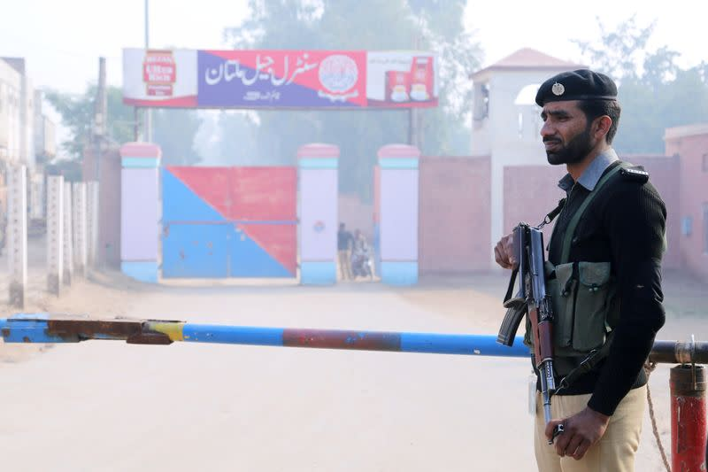 A police officer stands guard at the entrance of the Central Jail in Multan