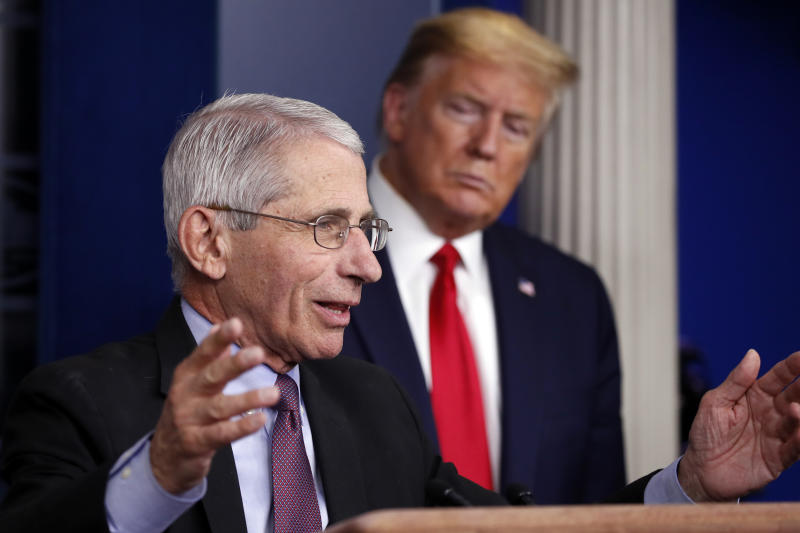FILE - In this April 22, 2020 file photo, President Donald Trump watches as Dr. Anthony Fauci, director of the National Institute of Allergy and Infectious Diseases, speaks about the coronavirus in the James Brady Press Briefing Room of the White House in Washington. (AP Photo/Alex Brandon)