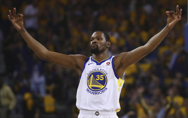 <p> Golden State Warriors' Kevin Durant celebrates a score against the San Antonio Spurs during the first quarter in Game 5 of a first-round NBA basketball playoff series Tuesday, April 24, 2018, in Oakland, Calif. (AP Photo/Ben Margot) </p>