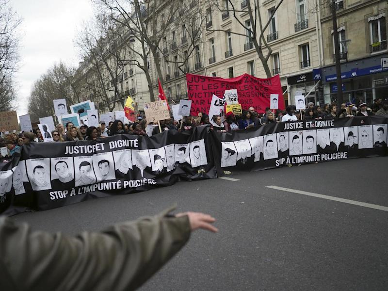 "People hold a banner reading ""Justice and dignity, stop to the police impunity"" during a demonstration against police violence, in Paris, Sunday, March 19, 2017. Protesters carried placards and banners as they gathered at Place de la Republique, a square in the centre of the French capital, to listen to speeches. (AP Photo/Thibault Camus)"