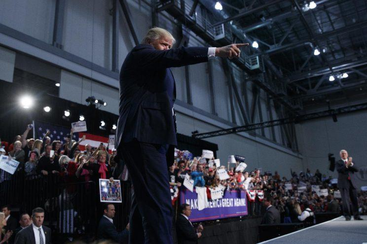 Donald Trump points to the crowd as he arrives to speak at a rally in Grand Rapids, Mich. (Photo: Evan Vucci/AP)
