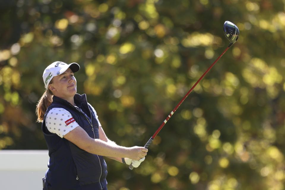 Gemma Dryburgh, of Scotland, watches her tee shot on the 14th hole during the first round of the LPGA Cambia Portland Classic golf tournament in Portland, Ore., Thursday, Sept. 16, 2021. (AP Photo/Steve Dipaola)
