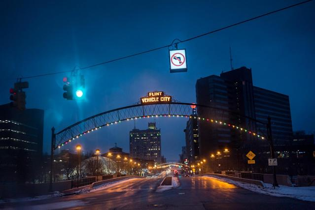 <p>The iconic Vehicle City sign hangs over the entrance to Downtown Flint. The city doesn't make vehicles any more but the pride of being the birthplace of General Motors still permeates amongst the residents. (Photograph by Zackary Canepari) </p>
