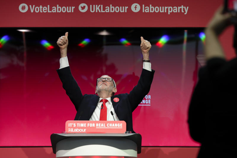 Jeremy Corbyn, Leader of Britain's opposition Labour Party gestures on stage at the launch of Labour's General Election manifesto, at Birmingham City University, England, Thursday, Nov. 21, 2019. Britain goes to the polls on Dec. 12. (AP Photo/Kirsty Wigglesworth)