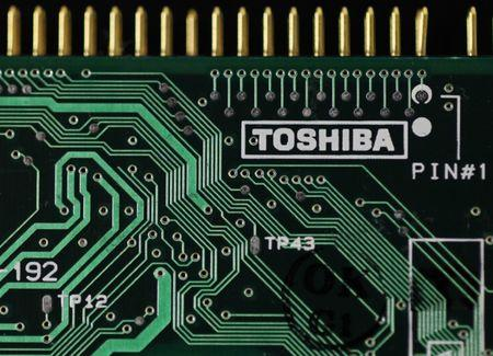 A logo of Toshiba is seen on a printed circuit board in this photo illustration taken in Tokyo