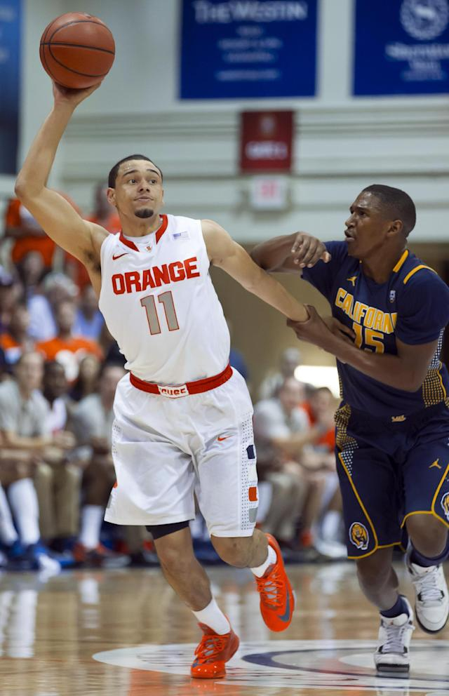 Syracuse guard Tyler Ennis (11) manages to steal the ball away from California guard Jordan Mathews (15) in the first half of an NCAA college basketball game at the Maui Invitational on Tuesday, Nov. 26, 2013, in Lahaina, Hawaii. (AP Photo/Eugene Tanner)