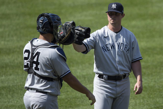 New York Yankees catcher Gary Sanchez (24) and pitcher Zack Britton celebrate after a baseball game against the Washington Nationals at Nationals Park, Sunday, July 26, 2020, in Washington. (AP Photo/Alex Brandon)