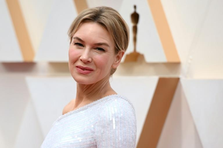 Renee Zellweger went for understated old school Hollywood glamour at the Oscars in her one-shoulder white gown -- she went on to win for best actress