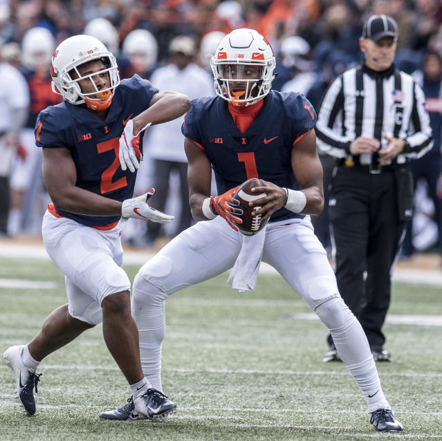 Illinois quarterback AJ Bush, Jr. (1) hands the ball off to running back Reggie Corbin (2) in the first half of a NCAA college football game aganist Minnesota, Saturday, Nov. 3, 2018, in Champaign, Ill. (AP Photo/Holly Hart)