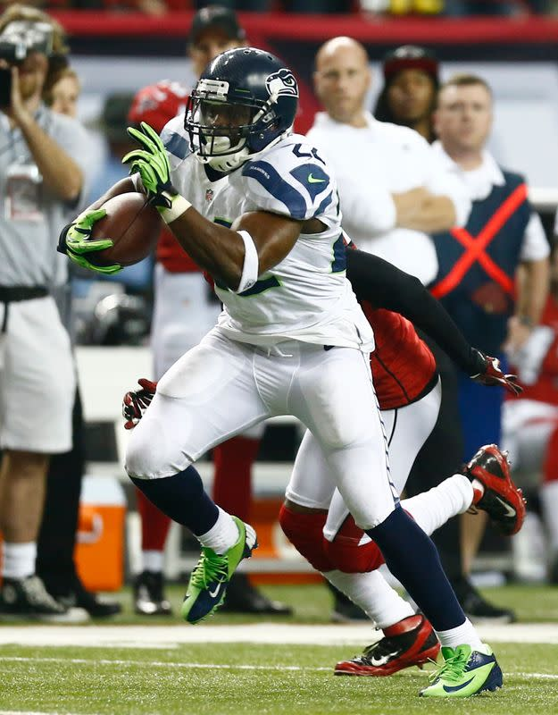 Seattle Seahawks running back Robert Turbin carries the ball against the Atlanta Falcons during the fourth quarter in their NFL NFC Divisional playoff football game in Atlanta