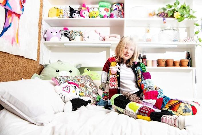LOS ANGELES, CA - NOVEMBER 23: Portrait of Olivia Huffman wearing the cardigan and pants she created from hand-knitted squares her followers mailed to her on Monday, Nov. 23, 2020 in Los Angeles, CA. (Mariah Tauger / Los Angeles Times)