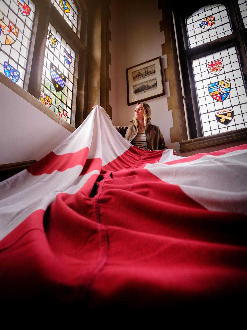 Staff at English Heritage historic sites prepare to fly the flag (English Heritage/PA)