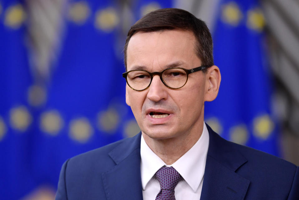 Poland's Prime Minister Mateusz Morawieckij speaks with the media as he arrives for an EU summit at the European Council building in Brussels, Thursday, Dec. 10, 2020. European Union leaders meet for a year-end summit that will address anything from climate, sanctions against Turkey to budget and virus recovery plans. Brexit will be discussed on the sidelines. (John Thys, Pool via AP)
