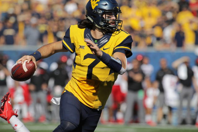 Will Grier (7) is back at West Virginia for his senior season. (AP Photo/Raymond Thompson, File)