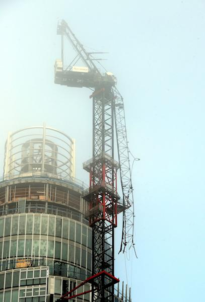 A general view of the damaged crane on top of St Georges Tower close to the scene where a helicopter crashed in central London, Wednesday Jan. 16, 2013. Police say two people were killed when a helicopter crashed Wednesday during rush hour in central London after apparently hitting a construction crane on top of a building. (AP Photo/PA, John Stillwell) UNITED KINGDOM OUT NO SALES NO ARCHIVE