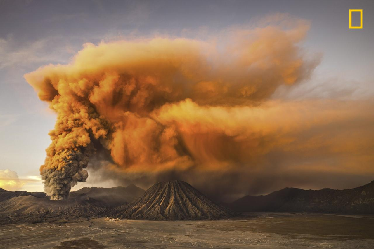 <p>The Mount Bromo volcano in Indonesia belches thick, orange smoke into the sky. (Reynold Riksa Dewantara/National Geographic travel photographer of the year) </p>