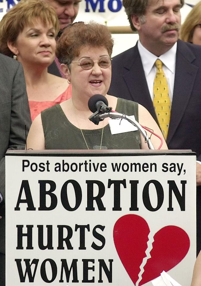 """Norma McCorvey, at microphone, plaintiff in the 1973 landmark case that legalized abortion, addresses the media and a large group of anti-abortion supporters, Tuesday June 17, 2003, in downtown Dallas. Attorneys for the """"Jane Roe"""" in the Dallas case that led the US Supreme Court to strike down laws banning abortion, filed a petition in federal court in Dallas seeking to reopen and set aside the ``Roe versus Wade'' decision. The motion asks a lower court to consider new evidence that abortion hurts women. Her attorney says since McCorvey was a party to the original litigation, she can petition the court to reopen the case. (AP Photo/Tony Gutierrez)"""