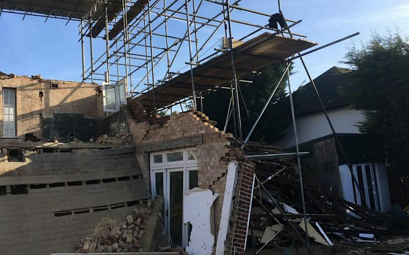 A wealthy family made a lucky escape after their luxury home collapsed in the middle of the night, leaving just a pile of rubble - Credit: Police/SWNS.COM