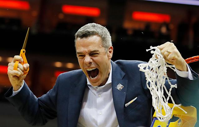 LOUISVILLE, KENTUCKY - MARCH 30: Head coach Tony Bennett of the Virginia Cavaliers celebrates after defeating the Purdue Boilermakers 80-75 in overtime of the 2019 NCAA Men's Basketball Tournament South Regional to advance to the Final Four at KFC YUM! Center on March 30, 2019 in Louisville, Kentucky. (Photo by Kevin C. Cox/Getty Images)