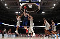 <p>Scottie James #31 of the Liberty Flames drives to the basket against Wabissa Bede #3 and Kerry Blackshear Jr. #24 of the Virginia Tech Hokies in the first half during the second round of the 2019 NCAA Men's Basketball Tournament at SAP Center on March 24, 2019 in San Jose, California. (Photo by Yong Teck Lim/Getty Images) </p>