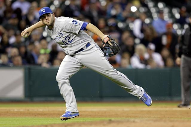 Kansas City Royals third baseman Mike Moustakas throws to first base for the out on Houston Astros' Matt Dominguez in the fourth inning of a baseball game Tuesday, April 15, 2014, in Houston. (AP Photo/Pat Sullivan)