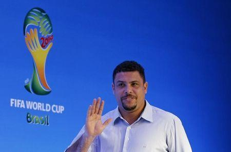 Ronaldo waves as he arrives at a news conference in Sao Joao da Mata