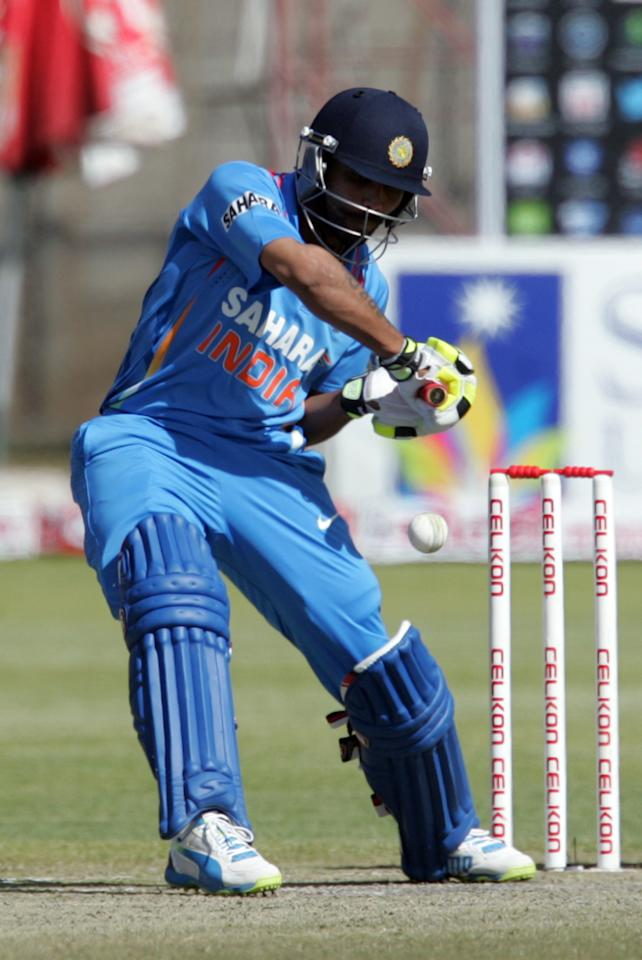 Indian player Ravindra Jadeja in action during  the final game of the 5 match cricket ODI series between hosts Zimbabwe and India at Queens Sports Club in Harare on August 3, 2013.  Legspinner Amit Mishra's six-wicket haul took India to a comprehensive one-day series whitewash in Zimbabwe as they beat the hosts by seven wickets in Saturday's fifth one-day international in Bulawayo. Mishra' figures of six for 48 saw Zimbabwe bowled out for just 163, and also took his wicket tally in the series to 18 - a new record for a five-match series. AFP PHOTO /Jekesai Njikizana.        (Photo credit should read JEKESAI NJIKIZANA/AFP/Getty Images)