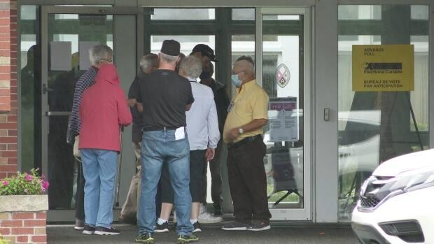 At St. Mark's Church in Saint John, some voters decided not to stay because of what could be a 90-minute wait, but others stuck it out.  (Graham Thompson/CBC - image credit)