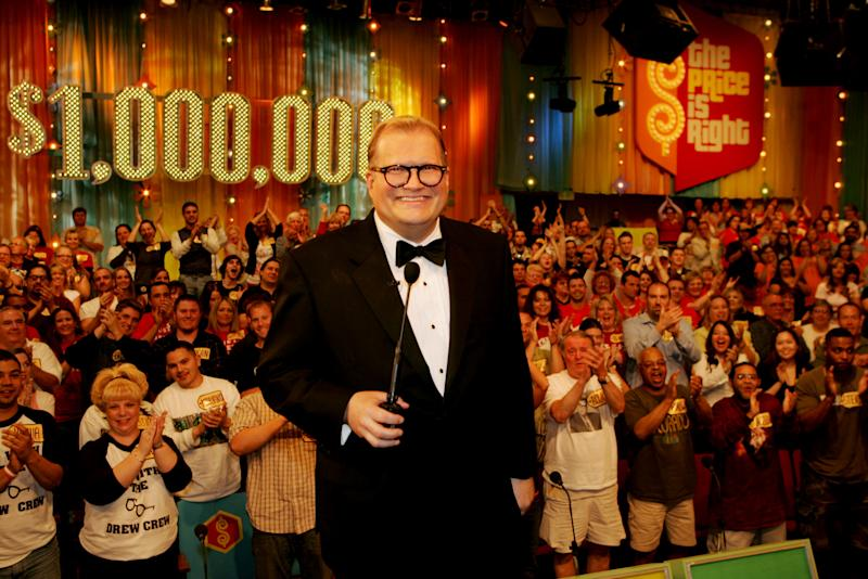"FILE - In this February 2008 publicity image released by CBS Entertainment, host Drew Carey hosts pauses during a taping of of ""The Price is Right Million Dollar Spectacular,"" one of six new specials to be broadcast on the CBS Television Network. A Los Angeles judge on Tuesday, March 12, 2013, overturned an $8.5 million jury verdict awarded to a former model on the show after determining that he had not properly instructed the panel. A retrial will be scheduled in Brandi Cochran's case versus the show's producers. (AP Photo/CBS, Monty Brinton, File) ** MANDATORY CREDIT. NO ARCHIVE. NO SALES. NORTH AMERICA USE ONLY. **"