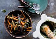 "For a little carrot-on-carrot action, don't throw away those leafy green tops. Use them in a pesto, instead. <a href=""https://www.bonappetit.com/recipe/roasted-carrots-with-carrot-top-pesto?mbid=synd_yahoo_rss"" rel=""nofollow noopener"" target=""_blank"" data-ylk=""slk:See recipe."" class=""link rapid-noclick-resp"">See recipe.</a>"