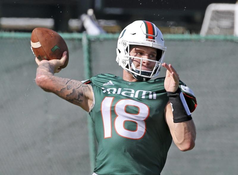 Miami quarterback Tate Martell (18) throws the ball during NCAA college football practice in Coral Gables, Fla., Wednesday, Aug. 7, 2019. (Charles Trainor Jr./Miami Herald via AP)
