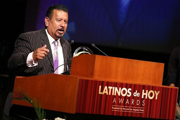 """<p>Richard Montañez, pictured at the Latinos de Hoy Awards, in partnership with The Los Angeles Times. The paper recently published allegations that his 'rags to riches' tale of inventing Flamin' Hot Cheetos is an """"urban legend""""</p> (Twitter/Latinos de Hoy Awards)"""