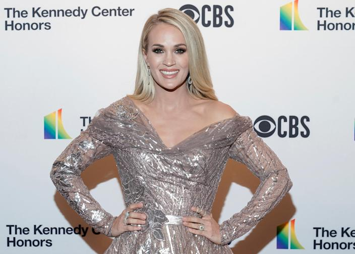 Singer Carrie Underwood features one of her sons on her new Christmas album.