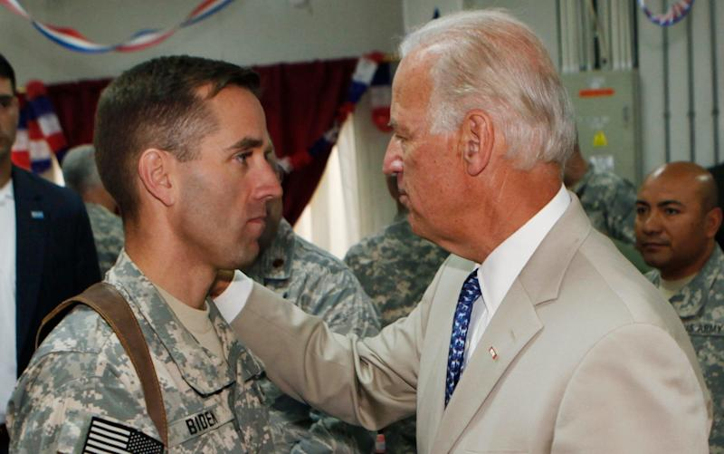 Joe Biden talks with his son Beau Biden at Camp Victory on the outskirts of Baghdad, Iraq in 2009 - Credit: AP