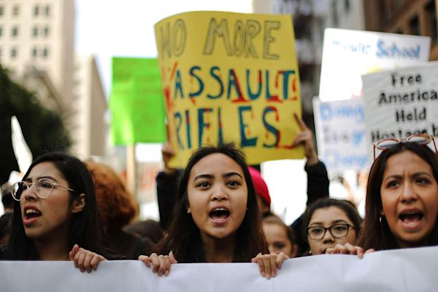 <p>Young activists chant before marching in Los Angeles. (Photo: Getty Images) </p>