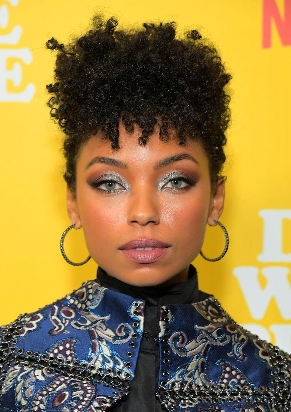 """<p>Faux-hawks are the best way to test out a haircut without committing to the scissors. And <strong>Logan Browning's</strong> version is all about an abundance of curls around the crown of the head. To secure this look, try using mini butterfly clips or bobby pins, depending on the length and weight of your hair.</p><p><strong>RELATED:</strong> <a href=""""https://www.goodhousekeeping.com/beauty/hair/g30681266/cute-hair-clips-barrettes/"""" rel=""""nofollow noopener"""" target=""""_blank"""" data-ylk=""""slk:24 Cute Hair Clips That Are Perfect for Your Next Zoom Call"""" class=""""link rapid-noclick-resp"""">24 Cute Hair Clips That Are Perfect for Your Next Zoom Call</a></p>"""
