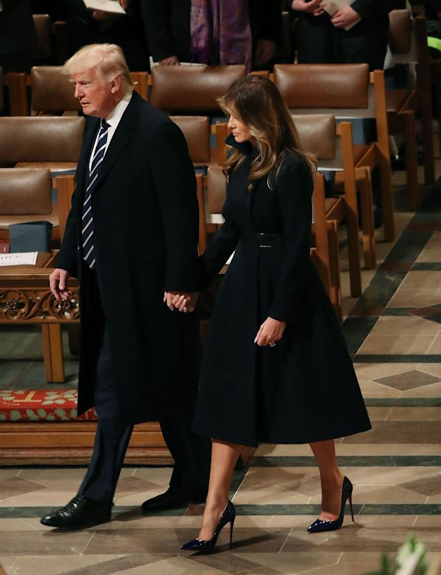 <p>For the National Prayer Service at the Washington National Cathedral, the First Lady chose a navy coat by designer Alice Roy. </p>