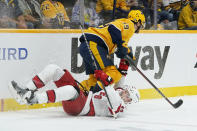Nashville Predators defenseman Roman Josi (59) and Carolina Hurricanes left wing Warren Foegele (13) collide during the first period in Game 3 of an NHL hockey Stanley Cup first-round playoff series Friday, May 21, 2021, in Nashville, Tenn. (AP Photo/Mark Humphrey)