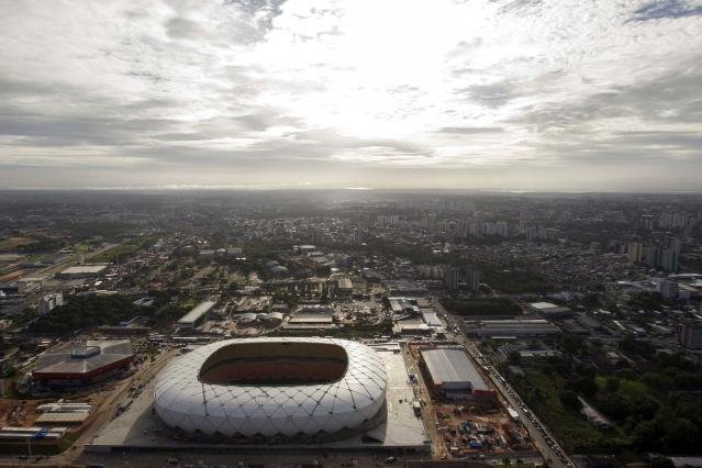 An aerial view is seen of the Arena Amazonia soccer stadium two days before its scheduled inauguration, in Manaus March 7, 2014. The Arena Amazonia will host four matches of the 2014 World Cup. REUTERS/Bruno Kelly (BRAZIL - Tags: SPORT SOCCER WORLD CUP)
