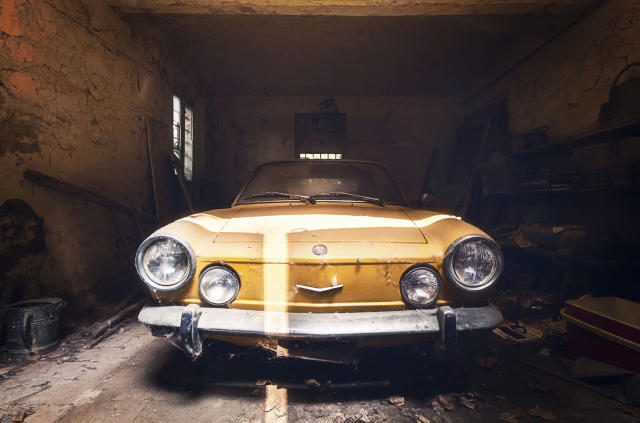 <p>The gallery includes: A typical old Italian car standing in a garage in an extremely good condition; an abandoned castle. (Photo: Roman Robroek/Caters News) </p>