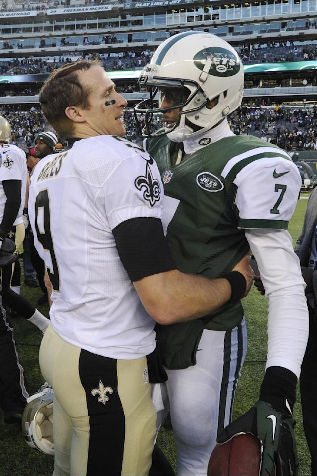 New Orleans Saints' Drew Brees (9) hugs New York Jets' Geno Smith (7) after an NFL football game Sunday, Nov. 3, 2013, in East Rutherford, N.J. The Jets won 26-20. (AP Photo/Bill Kostroun)