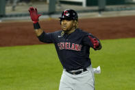 Cleveland Indians' Jose Ramirez celebrates as he runs home after hitting a solo home run during the eighth inning of a baseball game against the Kansas City Royals Wednesday, May 5, 2021, in Kansas City, Mo. (AP Photo/Charlie Riedel)