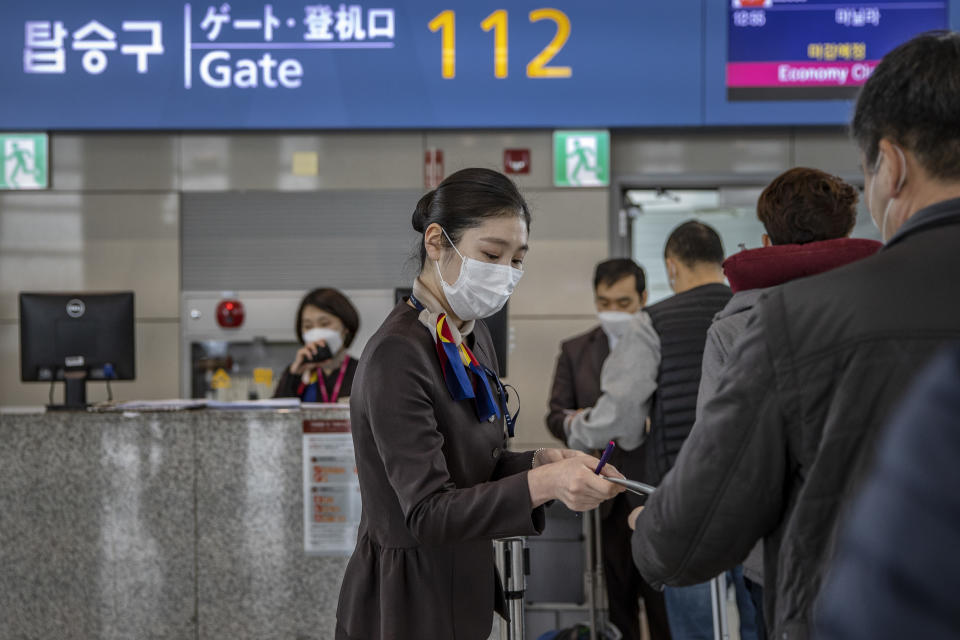 INCHEON, SOUTH KOREA - MARCH 10: Airport staff are seen wearing facemasks to protect themselves from COVID-19 inside Incheon International Airport on March 10, 2020 in Incheon, South Korea. According to the Korea Centers for Disease Control and Prevention, 131 new cases have been reported, with the death toll rising to 54. The total number of infections in the nation tallies at 7,513. (Photo by Ezra Acayan/Getty Images)
