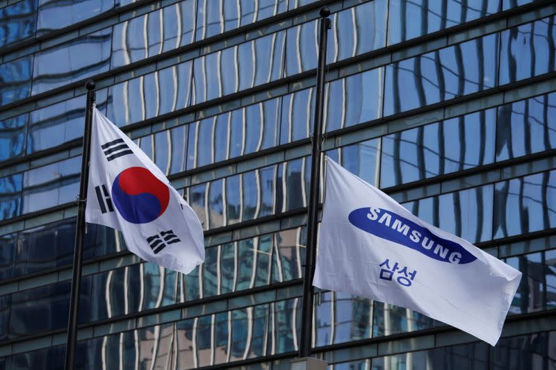 A flag bearing the logo of Samsung flutters at half-mast in front of its office building in Seoul