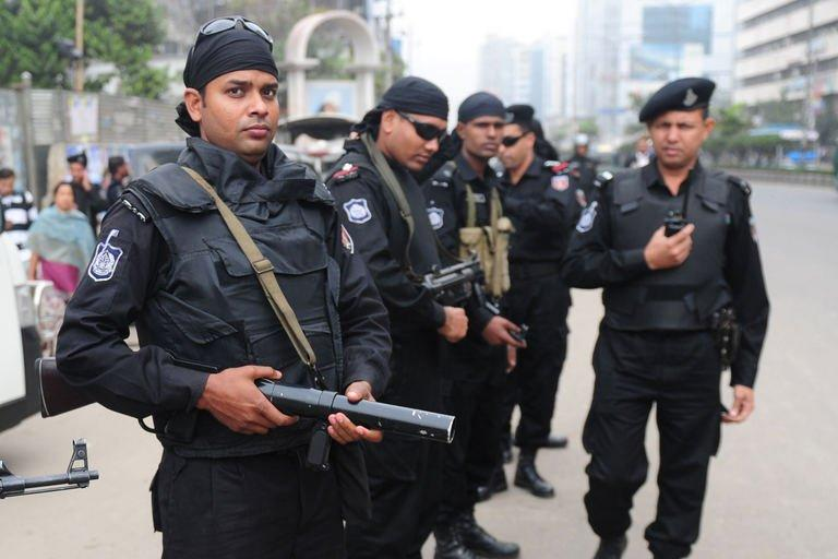 Rapid Action Battalion (RAB) personnel stand guard during a nationwide strike in Dhaka on February 18, 2013