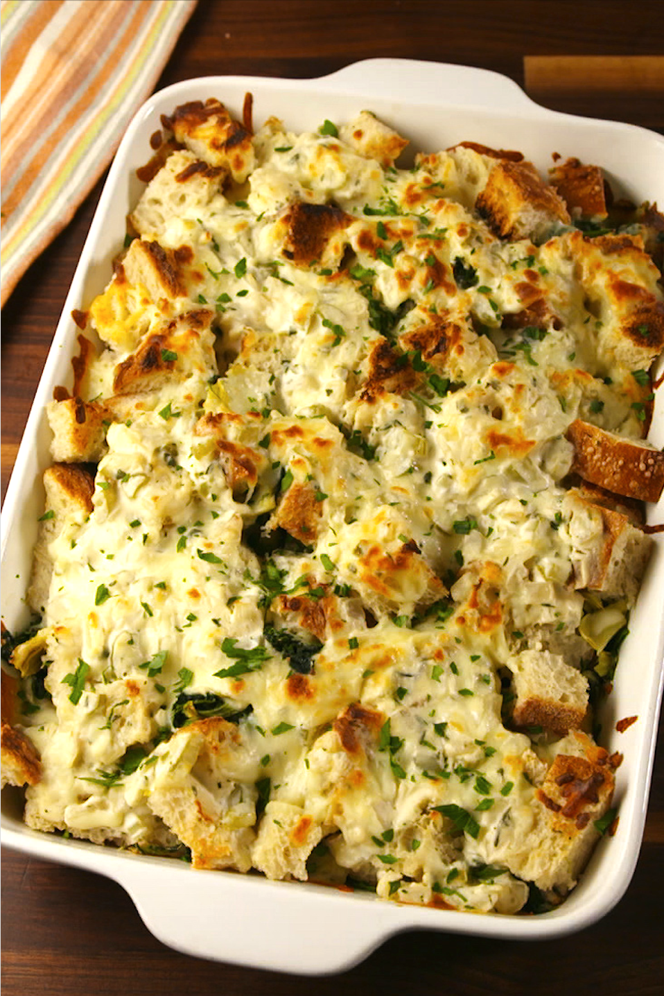 """<p>This is what your stuffing has been missing.</p><p>Get the recipe from <a href=""""https://www.delish.com/cooking/recipe-ideas/recipes/a56480/spinach-artichoke-stuffing-recipe/"""" rel=""""nofollow noopener"""" target=""""_blank"""" data-ylk=""""slk:Delish"""" class=""""link rapid-noclick-resp"""">Delish</a>. </p>"""