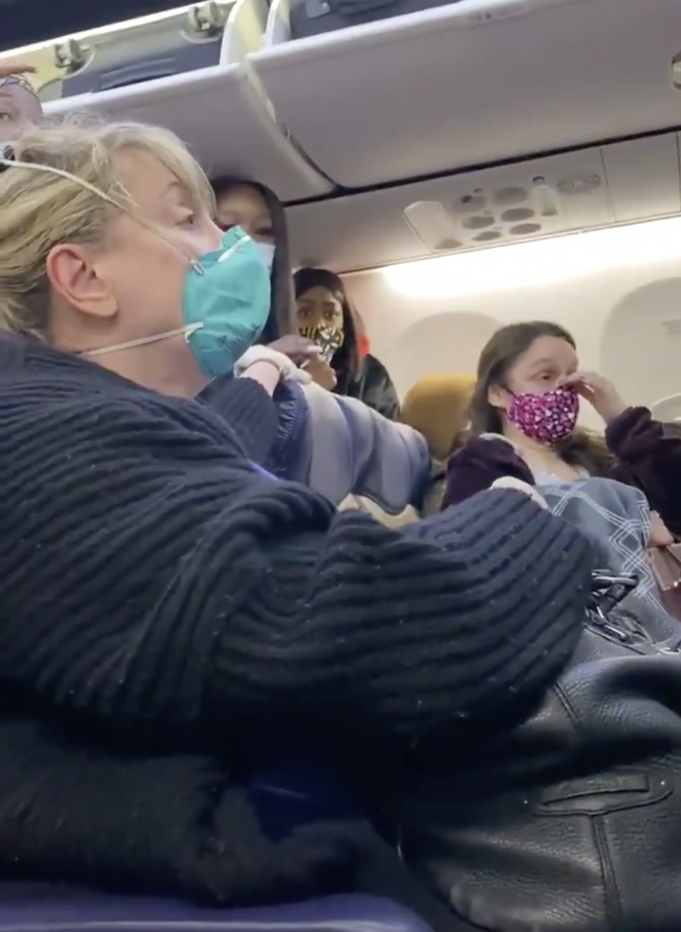 Woman seated on Southwest Airline plane.